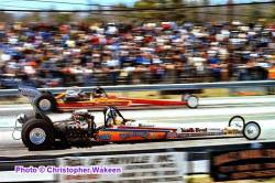 Neil Mahr and his SuperPress TF Dragster racing the Sundowners TFD at the 1980...